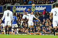 Ashley Williams of Everton jumps above Jack Cork of Swansea City. Premier league match, Everton v Swansea city at Goodison Park in Liverpool, Merseyside on Saturday 19th November 2016.<br /> pic by Chris Stading, Andrew Orchard sports photography.