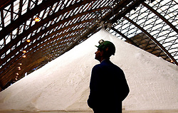 A Solvay Chemical employee, monitors the production of soda ash, at the Solvay plant in Jemeppe-sur-Sambre, Belgium. Solvay Chemical is the world's largest producer of soda ash, or sodium carbonate, which is used in the manufacturing of many products, from glass to laundry detergent. (Photo © Jock Fistick)