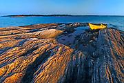 yellow kayak on shoal of Walton Island at sunrise on Georgian Bay near Snug Harbour<br />near Snug Harbour<br />Ontario<br />Canada