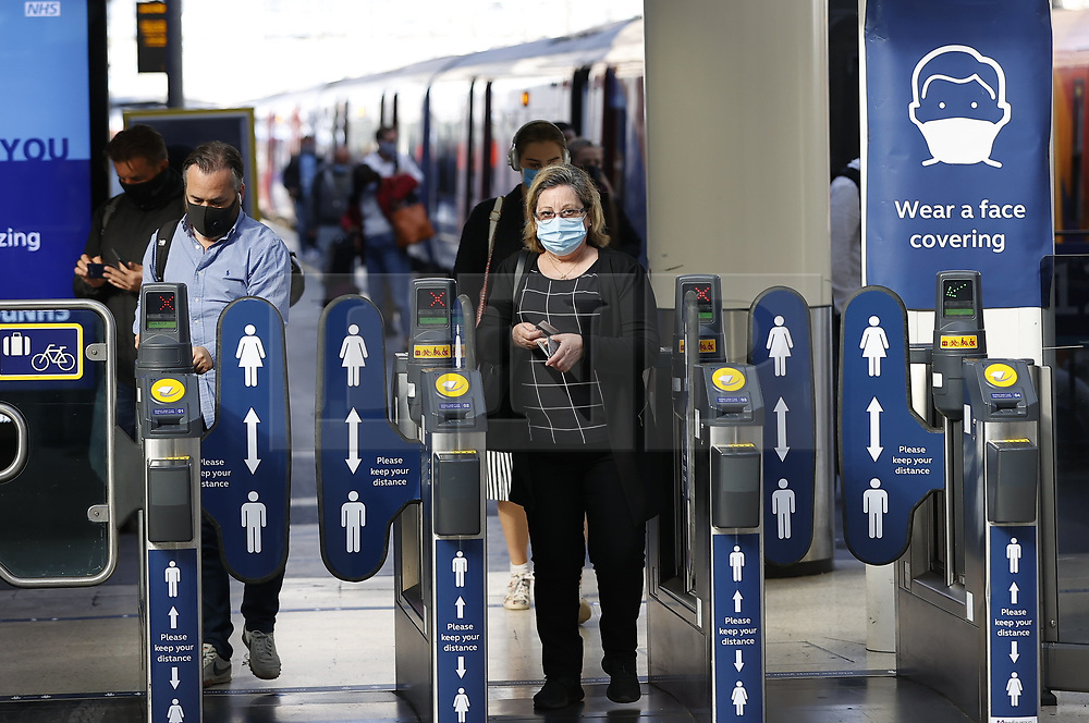© Licensed to London News Pictures. 15/06/2020. London, UK. Passengers wear face masks as they arrive at Waterloo Station. New rules allowing some non-essential retail businneses to open and mandatory face masks on public transport have started today. Photo credit: Peter Macdiarmid/LNP