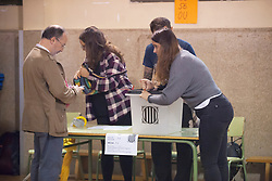 "© Licensed to London News Pictures. 01/10/2017. Barcelona, Spain.  <br /> <br /> Members of the organization setting the Sedeta de Gracia´s Centre Civic poll station up, a while ago.<br /> <br /> Students, their parents, associations and neighbours have organized to carry out ""playful activities"" during the weekend and keep open the Sedeta de Gracia´s Centre Civic.<br />  <br /> Since early in the morning dozens of people wait at the college´s door for the voting time under the rain.<br /> <br /> Mossos d´Escuadra said they won´t do nothing if that can destabilize social order.<br /> <br /> Catalonia is awaiting for today, October 1st, when the Spanish Region wants to vote in a self-determination referendum to get a independence.<br /> <br /> The Referendum´s Law was passed on last September 6th at the Catalonian Parliament thanks to the votes of ""Junts pel Sí"" and ""CUP"". Then it was suspended by the Spanish Constitutional Court, on next day.<br /> Carles Puigdemont, the President of the Government of Catalonia, said he would ignore that and he and his Government will continue with the Referendum.<br /> <br /> The Spanish Government has sent to Catalonia thousands of ""Guardia Civil"" and ""Policía Nacional"" officers (two of the Spanish forces and state security forces), to enforce the ruling of the Constitutional Court and avoid the voting process on next Sunday. They will work with the Mossos d´Escuadra (the Autonomic police in Catalonia).<br /> <br /> To avoid the vote, the Spanish Government has prevented the opening of polling stations, some of which are schools.  <br /> <br /> Photo credit: Gustavo Valiente/LNP"