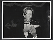 Toby Russell eating candy floss, Feather Ball. Hammersmith Palais, 19 December 1988Exhibition in a Box