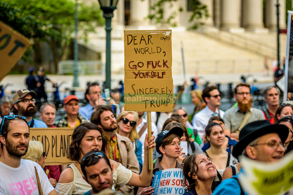 June 1, 2017 - New York, New York, United States - Activist groups and concerned citizens held a rally at Foley Square and then marched to New York City Hall in protest of Trump's attack on the Paris climate agreement. (Credit Image: © Erik Mcgregor/Pacific Press via ZUMA Wire)