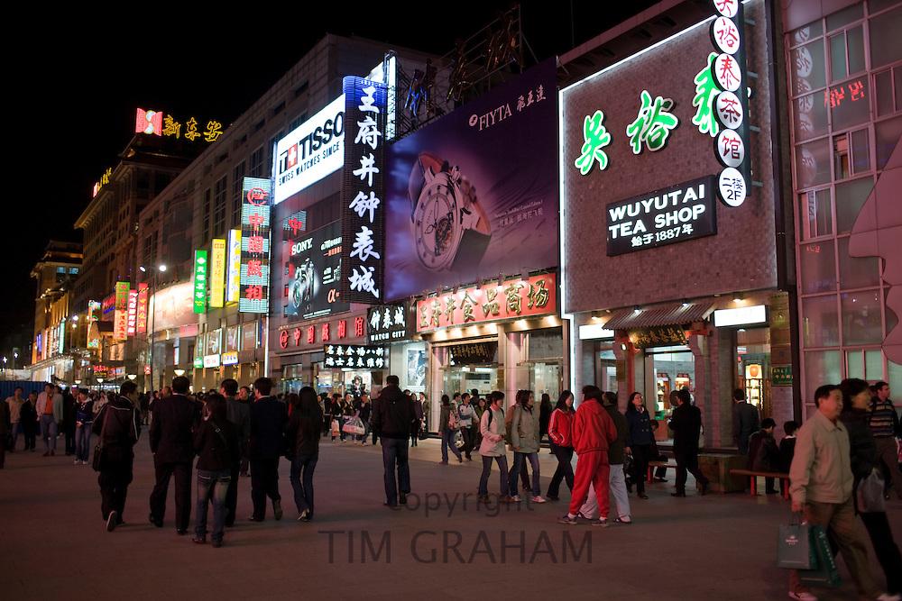 Crowded pavement and shops of Wangfujing Street, Beijing, China
