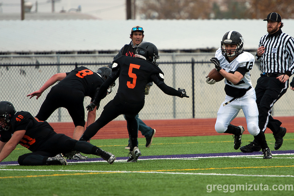Vale senior running back Zac Jacobs jukes by a trio of Scio defenders (L to R: Logan Gray, Dru Cook,and Brody Foster) for a 35 yard touchdown run to put Vale up 14-0 in the 3A semifinal playoff game at Kennison Field, Hermiston, Oregon, Saturday, November 21, 2015.<br /> <br /> Jacobs finished with 267 rushing years and four touchdowns in Vale's 42-14 win.