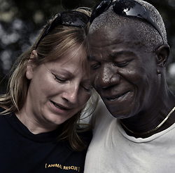 March 6, 2016 - Charlesville, Liberia - ''Those chimps are living things. They are us,'' says JOSEPH THOMAS, with LCR (Liberian Chimpanzee Rescue), a program of Humane Society of the United States.  KATHLEEN CONLEE with HSUS hugs him as they hold back tears on an island designated as new sanctuary to be built for the chimps.  He was formerly employed by New York Blood Center which stopped all funding for food and water when they retired the chimps formerly used for experimentation. HSUS and NYBC came to an agreement recently in May 2017 after years of discussion about the care of research chimps NYBC had abandoned..In March 2016, a team from HSUS visits to view the situation.  NYBC also refused to pay their original caregivers who had worked for the center and were abandoned as well.  They initially used their own meager finances to continue feeding them.  Over 60 chimps now live on six islands serving as a sanctuary run by Jenny and James Desmond to improve the dire situation in which the chimpanzees were left to die. (Credit Image: © Carol Guzy via ZUMA Wire)
