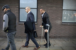 © Licensed to London News Pictures. 05/01/2018. Guildford, UK. Crystal Palace football club captain Jason Puncheon (R) leaves Guildford Magistrates Court. He is charged with various offences including  common assault  and possession of an offensive weapon after an altercation outside a nightclub in Reigate in the early hours of December 17th, 2017. Photo credit: Peter Macdiarmid/LNP