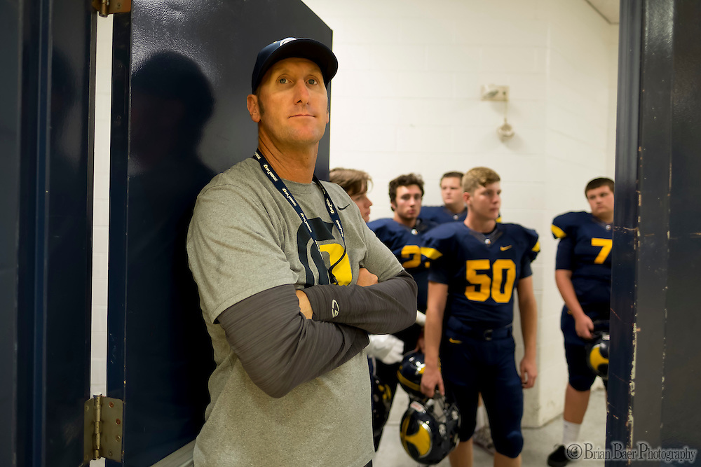 Oak Ridge Trojans head coach Eric Cavaliere looks inside as the Oak Ridge Trojans warm up inside the gym out of the rain before the game as the they host the Granite Bay Grizzlies, Friday Oct 14, 2016.<br /> photo by Brian Baer