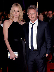 Sean Penn (right) and partner Charlize Theron attend the World Premiere of The Gunman at the BFI South Bank, London.  PRESS ASSOCIATION Photo. Picture date: Monday February 16, 2015.Photo credit should read: Anthony Devlin/PA Wire