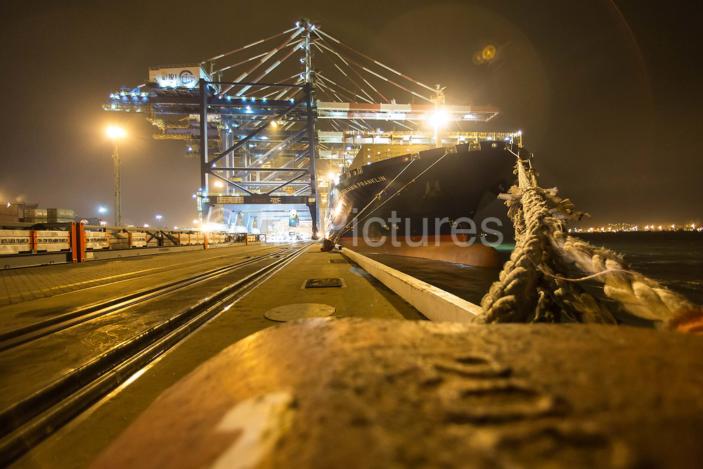 CMA CGM SAs Benjamin Franklin container ship being loaded at the Xiamen Songyu Container Terminal at night in Xiamen, China, on Saturday, Jan. 30, 2016. The Benjamin Franklin is the largest container ship ever to have docked at a U.S. port.