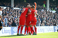 Danny Ings of Liverpool (c) celebrates with his teammates after scoring his teams 1st goal. Barclays Premier League match, Everton v Liverpool at Goodison Park in Liverpool on Sunday 4th October 2015.<br /> pic by Chris Stading, Andrew Orchard sports photography.