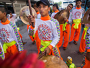 """05 JULY 2014 - BANGKOK, THAILAND:  A drummer performs for Chinese style lion dancers in Bangkok during a parade for vassa. Vassa, called """"phansa"""" in Thai, marks the beginning of the three months long Buddhist rains retreat when monks and novices stay in the temple for periods of intense meditation. Vassa officially starts July 11 but temples across Bangkok are holding events to mark the holiday all week.   PHOTO BY JACK KURTZ"""