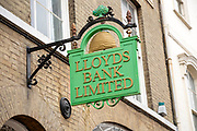 Old style historic vintage Llloyds Bank Limited sign on wall outside High Street branch, UK