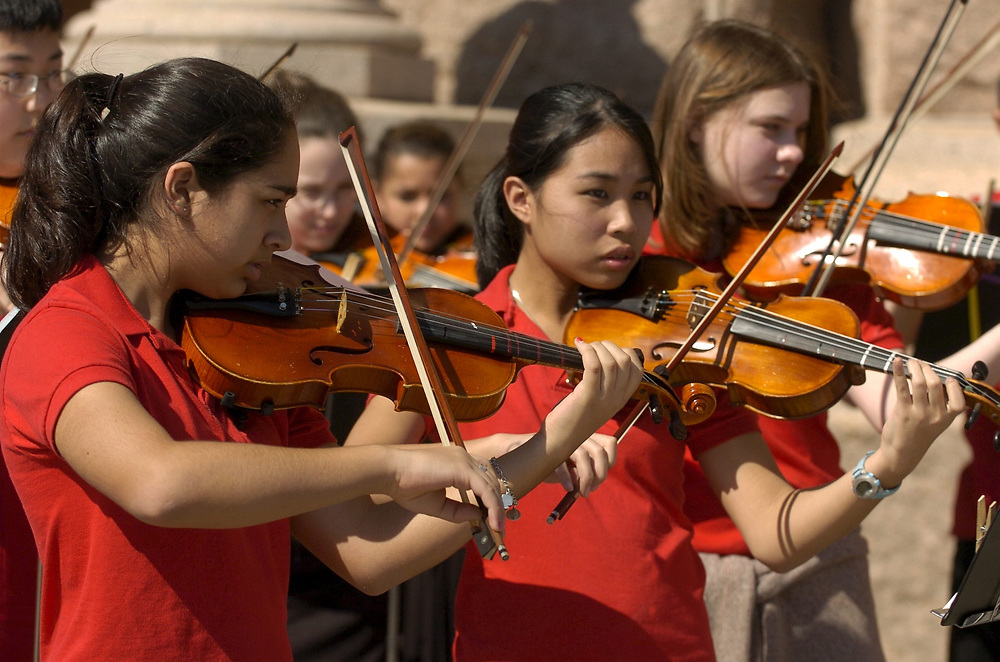Austin, TX 28FEB05: The Chisolm Trail Middle School Honor Orchestra of Round Rock, TX performs at the Texas Capitol in support of more Arts Education funding in Texas schools. <br /> ©Bob Daemmrich/