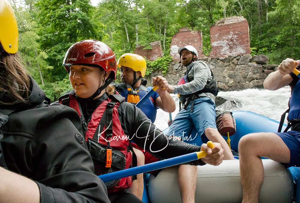 "Guide Marty Parichand of Outdoor New England gives his team of paddlers commands as they navigate through the rapids on the Winnipesaukee River during Mill City Park's ""Winni River Days"" whitewater festival in Franklin on Saturday. (paddlers Jon Hinson, Alicia Carroll, Abhas Joshi, guide Marty Parichand.  Not pictured Joe Astle, Jenisha Shrestha and Carly Ireland.    (Karen Bobotas/for the Laconia Daily Sun)"