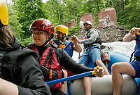 """Guide Marty Parichand of Outdoor New England gives his team of paddlers commands as they navigate through the rapids on the Winnipesaukee River during Mill City Park's """"Winni River Days"""" whitewater festival in Franklin on Saturday. (paddlers Jon Hinson, Alicia Carroll, Abhas Joshi, guide Marty Parichand.  Not pictured Joe Astle, Jenisha Shrestha and Carly Ireland.    (Karen Bobotas/for the Laconia Daily Sun)"""