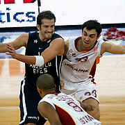 Galatasaray MP's Ender Arslan (R) and Anadolu Efes's Kerem Tunceri (L) during their Euroleague Top 16 basketball match Galatasaray MP between Anadolu Efes at the Abdi Ipekci Arena in Istanbul at Turkey on Wednesday, February, 22, 2012. Photo by TURKPIX