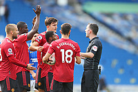 Football - 2020 / 2021 Premier League - Brighton and Hove Albion vs. Manchester United<br /> <br /> Referee Mr Chris Kavanagh is surrounded by Manchester United players claiming hand ball in the dying moments at The Amex Stadium Brighton <br /> <br /> COLORSPORT/SHAUN BOGGUST
