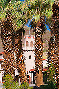 Scottys Castle through palm trees, Death Valley National Park. California