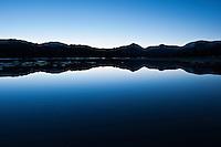 Dawn mountain reflection over a flooded Tuolumne Meadows, Yosemite national park, California