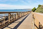 Walkers Crossing Over the Pedestrian Bridge on San Clemente's Beach Trail