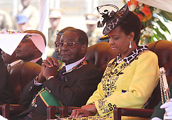 President Robert Mugabe (L) looks on with his wife Grace during the Zimbabwe Defence Forces match during 35th Anniversay celebrations at the National sports stadium in Harare,Zimbabwe,August 11,2015.Xinhua/Stringer) (Photo by Xinhua/Sipa USA)