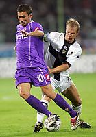 Firenze 20/09/2006<br /> Campionato Italiano Serie A 2006/07<br /> Fiorentina-Parma<br /> Mutu contrastato da Grella<br /> Foto Luca Pagliaricci Inside