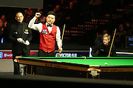 China's Ding Junhui celebrates after completing a 147 break during his match against Neil Robertson of Australia. Betvictor Welsh Open snooker 2016, day 5 at the Motorpoint Arena in Cardiff, South Wales on Friday 19th Feb 2016.  <br /> pic by Andrew Orchard, Andrew Orchard sports photography.