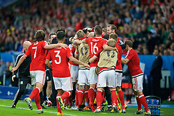 LILLE, FRANCE - Friday, July 1, 2016: Wales' Hal Robson-Kanu is mobbed by players and staff after scoring the second goal against Belgium to make the score 2-1 during the UEFA Euro 2016 Championship Quarter-Final match at the Stade Pierre Mauroy. (Pic by Paul Greenwood/Propaganda)