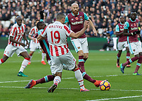 Football - 2016 / 2017 Premier League - West Ham United vs. Stoke City<br /> <br /> Pedro Obiang of West Ham gets a foot in before the advancing Jonathan Walters of Stoke City can get to the ball at The London Stadium.<br /> <br /> COLORSPORT/DANIEL BEARHAM