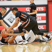 121914  Adron Gardner/Independent<br /> <br /> Gallup Bengals Shawn Eskeets (23), left, and Cody Tabaha (13) converge above Piedra Vista Panther XXX (24) during the Eddie Peña Holiday Classic in Grants Friday.