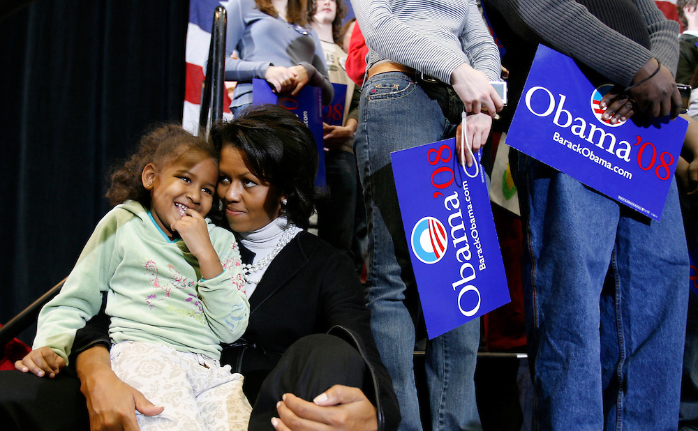 2/11/07 -- Waterloo, IA, U.S.A.Michelle Obama holds her daughter Sasha, 5, during her father's speech at a rally at the Hilton Coliseum in Ames, Iowa one day after declaring his candidacy for President.