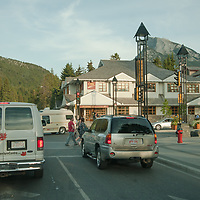 Traffic and tourists move through the town of Banff in Banff National Park, Alberta, Canada.
