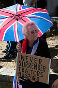 Pro-Brexit leave protester with Union Jack umbrella outside The Supreme Court as the last day of the hearing to rule on the legality of suspending or proroguing Parliament begins on September 19th 2019 in London, United Kingdom. The ruling will be made by 11 judges in the coming days to determine if the action of Prime Minister Boris Johnson to suspend parliament and his advice to do so given to the Queen was unlawful.