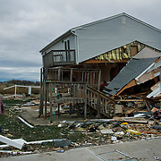 Men pass by destroyed homes in Union Beach, NJ after Superstorm Sandy. Superstorm Sandy's storm-surge, which destroyed several oceanfront blocks of Union Beach, leveled homes or lifted them off their foundations, breaking them apart and moving them.