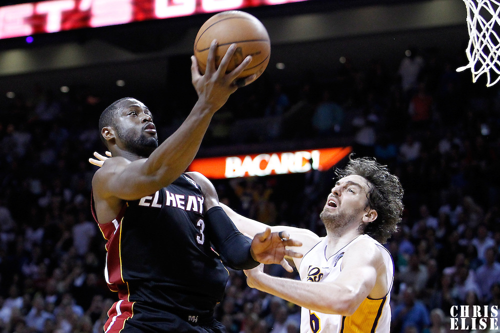 10 March 2011: Miami Heat shooting guard Dwyane Wade (3) goes for the layup against Los Angeles Lakers power forward Pau Gasol (16) during the Miami Heat 94-88 victory over the Miami Heat at the AmericanAirlines Arena, Miami, Florida, USA.
