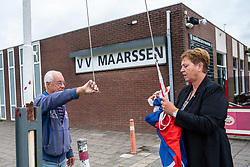 "Hetty Veneklaas, Alderman for Social Domain, Education and Sports at the Municipality of Stichtse Vecht receives the first copy of ""Presentation guide VV Maarssen 2020-2021"" from VV Maarssen chairman Bert van der Meijden on September 4, 2020 at Sportpark Daalseweide in Maarssen"