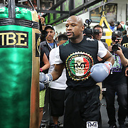 LAS VEGAS, NV - APRIL 14: WBC/WBA welterweight champion Floyd Mayweather Jr. prepares to hit the heavy bag as he works out at the Mayweather Boxing Club on April 14, 2015 in Las Vegas, Nevada. Mayweather will face WBO welterweight champion Manny Pacquiao in a unification bout on May 2, 2015 in Las Vegas.  (Photo by Alex Menendez/Getty Images) *** Local Caption *** Floyd Mayweather Jr.
