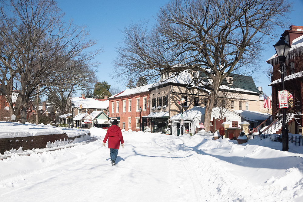 Pedestrian in snow around State Circle in Annapolis, Maryland