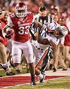Arkansas running safety Korliss Marshall (33) is pursued by Auburn defensive back Jonathon Mincy (6)) during an NCAA college football game in Fayetteville, Ark., Saturday, Nov. 2, 2013. Auburn defeated Arkansas 35-17. (AP Photo/Beth Hall)