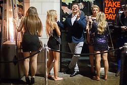 © licensed to London News Pictures. London, UK 01/01/2014. Revellers in Soho, London queuing outside a club whilst celebrating the New Year at the first hours of 2014. Photo credit: Tolga Akmen/LNP