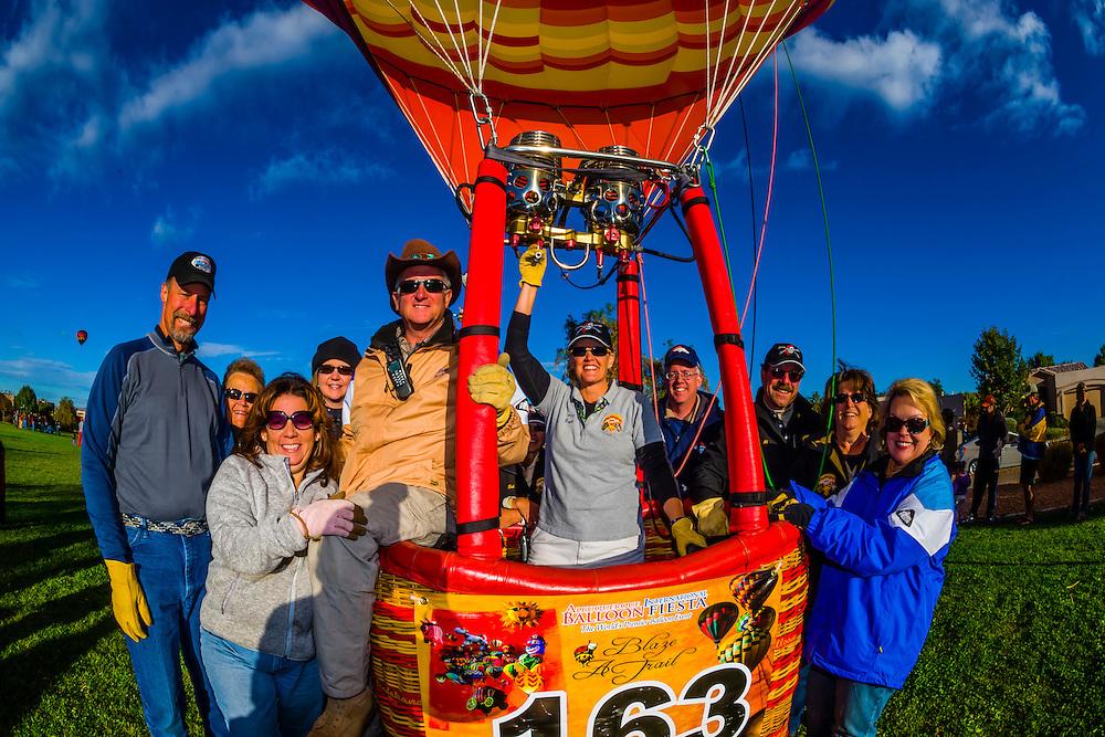 Balloon pilots David Eichhorn and Gayle Blackaby (Marauder's Mark) with their chase crew after landing in Desert Ridge Trails Park during the Albuquerque International Balloon Fiesta, Albuquerque, New Mexico USA.