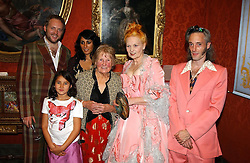 Left to right, JOE CORRE son of Vivienne Westwood, his wife SERENA REES and their daughter CORA, Vivienne Westwood's mother, VIVIENNE WESTWOOD and her son BEN WESTWOOD  at a reception to open an exhibition entitled 'Boucher Seductive Visions' at The Wallace Collection, Manchester Square, London W1 on 29th September 2004.NON EXCLUSIVE - WORLD RIGHTS