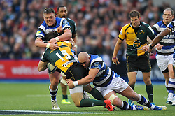 Ben Foden (Northampton) is tackled by David Wilson and Carl Fearns (Bath) - Photo mandatory by-line: Patrick Khachfe/JMP - Tel: Mobile: 07966 386802 23/05/2014 - SPORT - RUGBY UNION - Cardiff Arms Park, Cardiff - Bath Rugby v Northampton Saints - Amlin Challenge Cup Final.