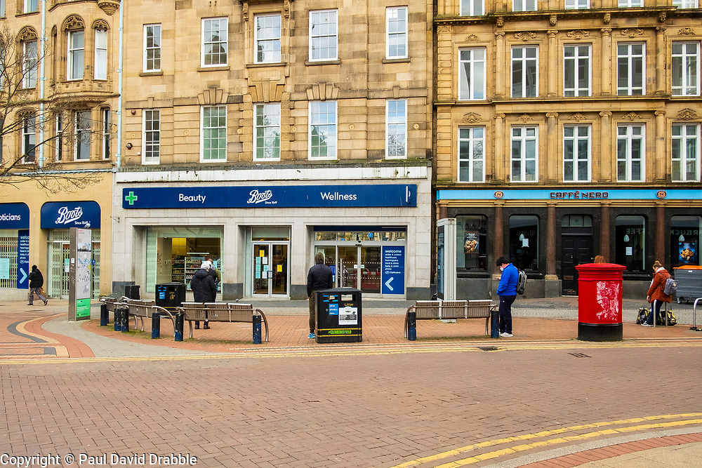 Sheffield Friday 3 April 2020 <br /> Coronavirus Covid-19 Sheffields second week of Lockdown social distance queuing outside Boots Chemist at the bottom of Fargate <br /> 3 April 2020<br /> <br /> www.pauldaviddrabble.co.uk<br /> All Images Copyright Paul David Drabble - <br /> All rights Reserved - <br /> Moral Rights Asserted -