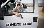 """Mountain Minuteman Robert """"Lil Dog"""" Crooks displays a hand gun he uses for safety while on patrol at Patriot Point along the U.S.-Mexico border in Campo, California on Saturday, November 17, 2018 in Campo California.  Crooks, who has been on look-out at the border for over Ten Years, alerts Border Patrol agents to illegal or suspicious activity."""