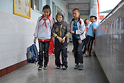 CHENGDU, CHINA - APRIL 28: (CHINA OUT) <br /> <br /> Cling film Boy<br /> <br /> EB sufferer Liu Liangchen is  accompanied by classmates after school  in Chengdu, Sichuan Province of China. Liu Liangchen, 14, was born with Epidermolysis bullosa (EB), an inherited connective tissue disease causing blisters in the skin and mucosal membranes. He is 1.1m tall and weighs less than 15kg. He doesn't have any finger nails and toe nails. He wraps himself with clingfilm to alleviate the pain, and wears long-sleeved clothes and long trousers all the year round. <br /> ©Exclusivepix