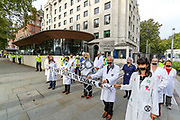 Extinction Rebellion nurses staged a protest outside Metropolitan Police office known as New Scotland Yard holding a banner which reads 'Don't Silence the Science' on Wednesday, Sept 9, 2020 - to highlight their resistance after healthcare professionals were threatened with disciplinary action for speaking out about their work during the coronavirus outbreak. Environmental nonviolent activists group Extinction Rebellion enters its 9th day of continuous ten days protests to disrupt political institutions throughout peaceful actions swarming central London into a standoff, demanding that central government obeys and delivers Climate Emergency bill. (VXP Photo/ Vudi Xhymshiti)
