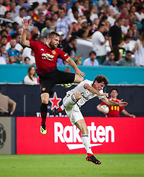 July 31, 2018 - Miami Gardens, Florida, USA - Real Madrid C.F. defender Alvaro Odriozola (19) (right) reacts after suffering a hit by Manchester United F.C. defender Luke Shaw (23) (left) during an International Champions Cup match between Real Madrid C.F. and Manchester United F.C. at the Hard Rock Stadium in Miami Gardens, Florida. Manchester United F.C. won the game 2-1. (Credit Image: © Mario Houben via ZUMA Wire)