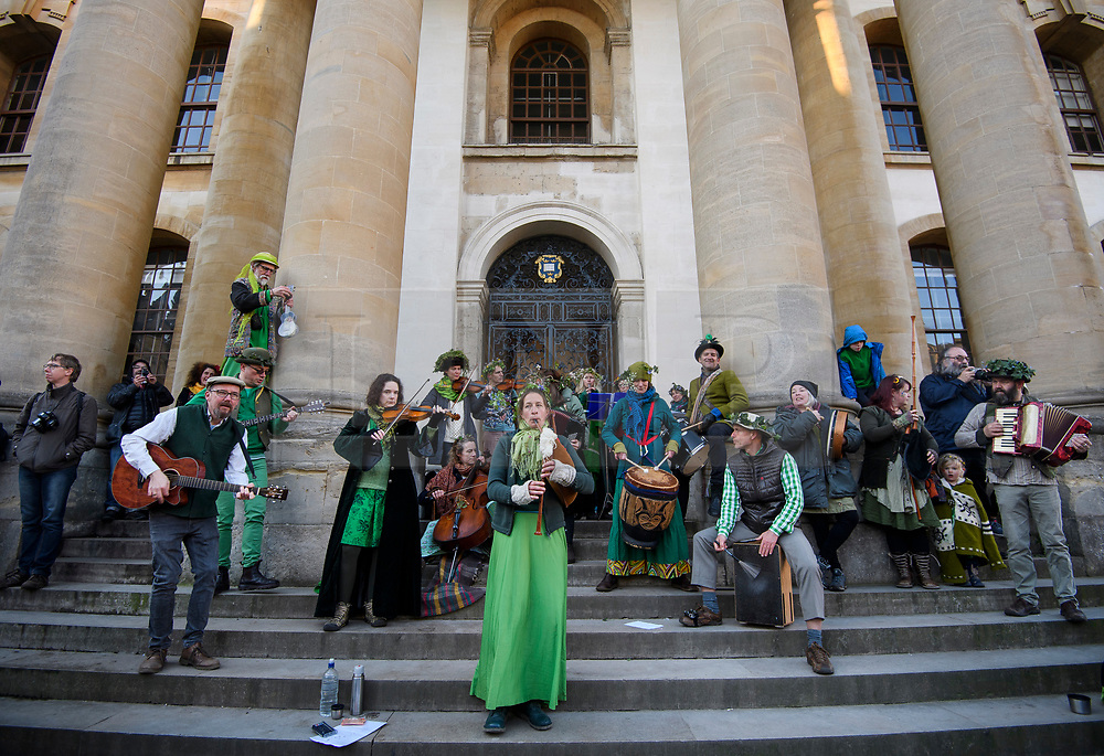 © Licensed to London News Pictures. 01/05/2018. Oxford, UK. A band performs traditional music outside the Clarendon Building at Oxford University during celebrations for May Day in the early hours of the morning. Students were again prevented from jumping from Magdalen Bridge in to the river, which has historically been a tradition, due to injuries at a previous years event . Photo credit: Ben Cawthra/LNP